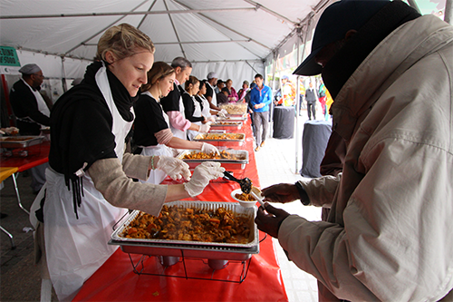 Women serving food to community - Food Donation