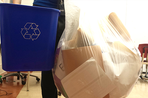 Paper recycling bin and a bag of collected paper