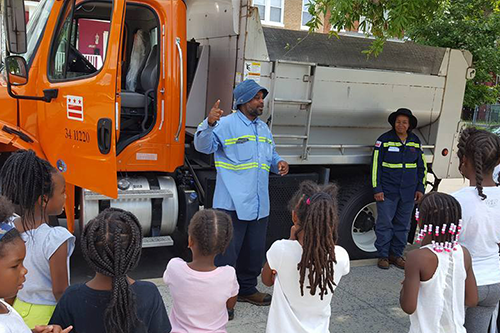 SWEEP inspector teaching kids about recycling through the SWEEP Jr. program