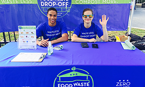 man and women at Food Waste Drop off Table